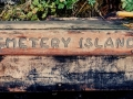 Cemetery Island sign on dock