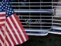 Small Flag in front of '70s-vintage Cadillac