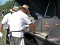 Cooking brats on the World's Largest Grill at EAA